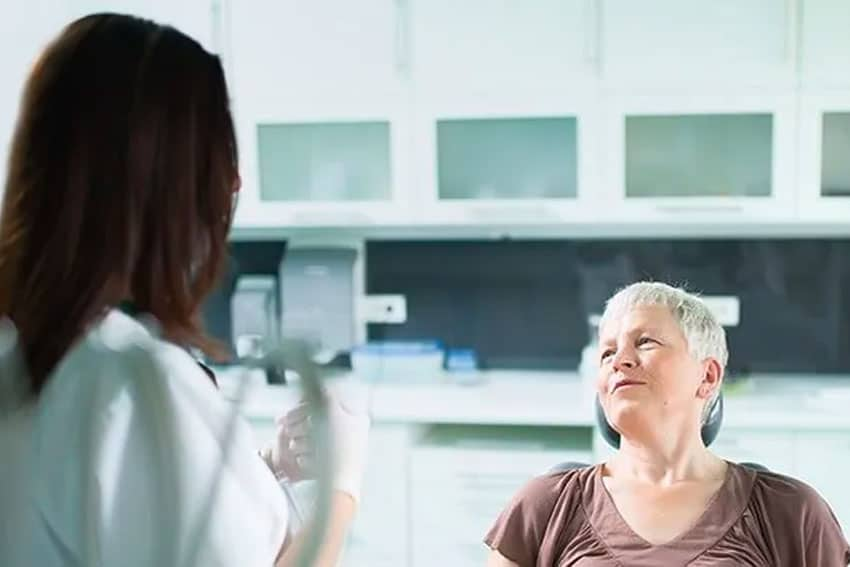 woman discussing her dental care needs in the office