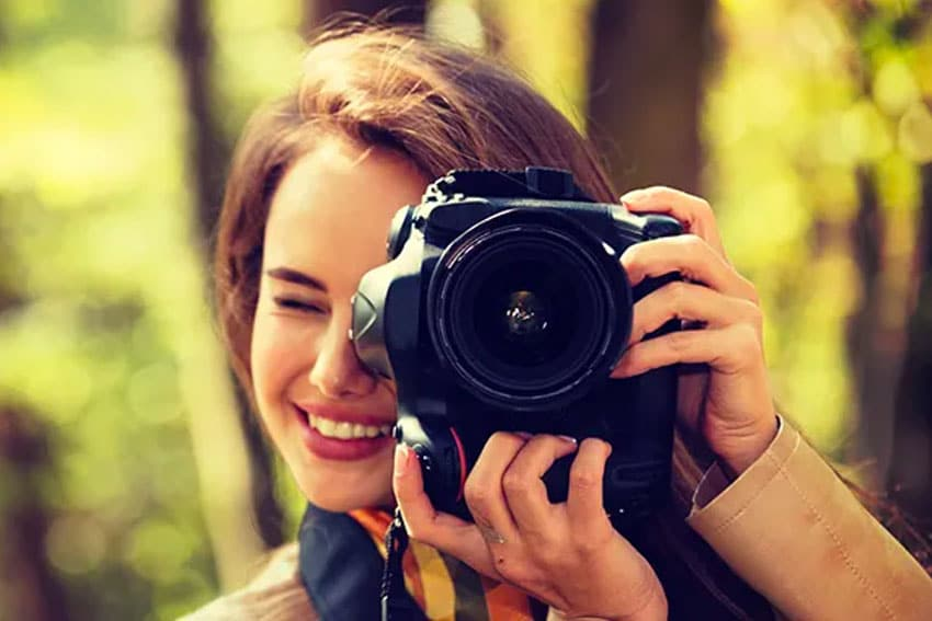 young pretty girls taking a picture with her camera