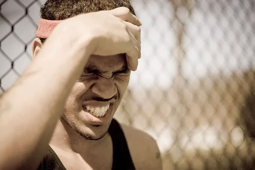 basketball playing suffering from a headache